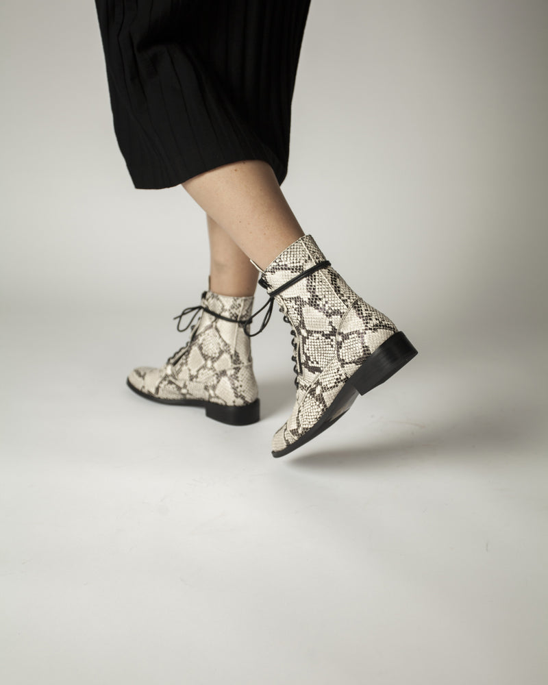 Black and white snakeskin leather flat lace-up boots that have a side zipper fastening and features a short block heel and a round toe by 2 Baia Vista.