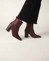 Red leather ankle boots that have inner zipper fastening and feature a 7.5 cm block heel and a pointed toe by Zomp.