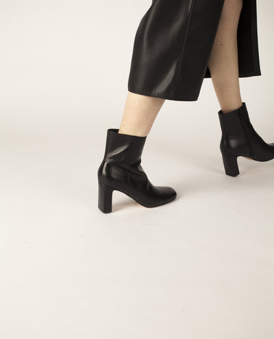 Classic black leather ankle boots that have inner zipper fastening and feature a modern rectangle 7.5 cm block heel and a soft square toe by Zomp.