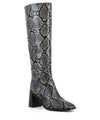 Black and white snakeskin knee high boots featuring side zipper fastenings, a high block heel and a square toe by 2 Baia Vista.
