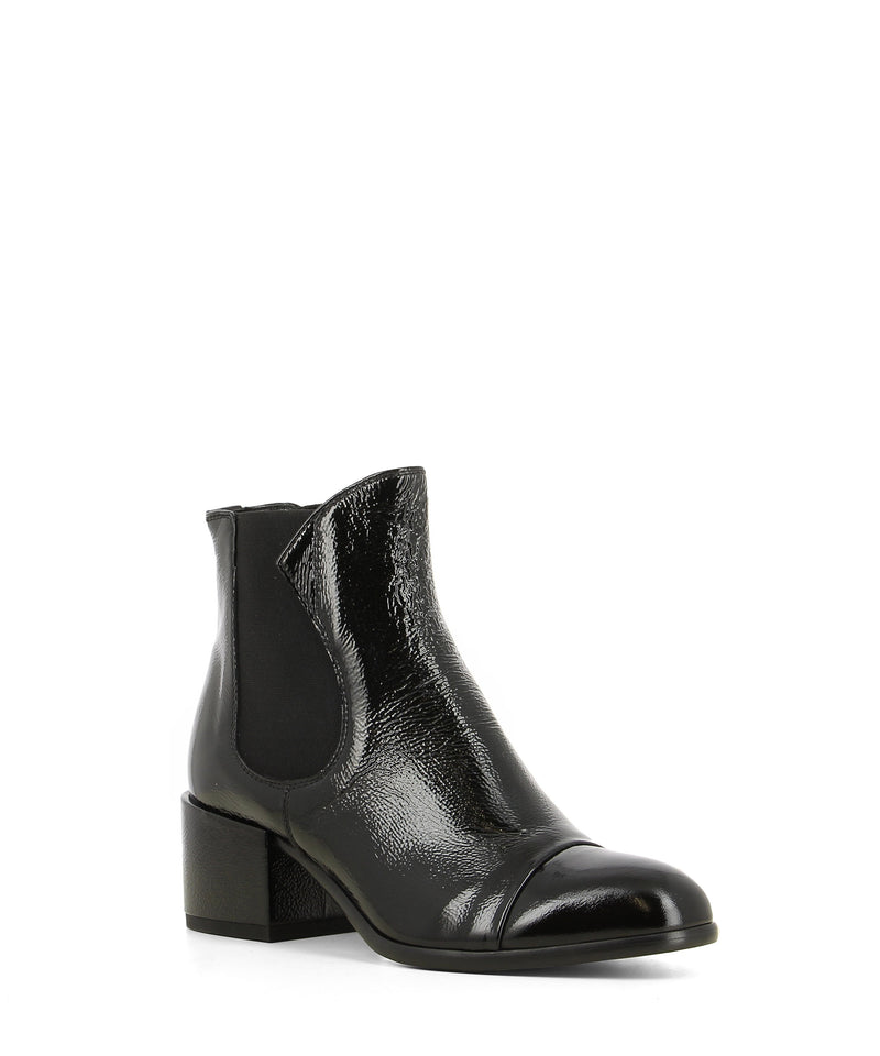 A black patent leather Chelsea ankle boot that features a 5cm block heel and an almond toe by Beau Coops.