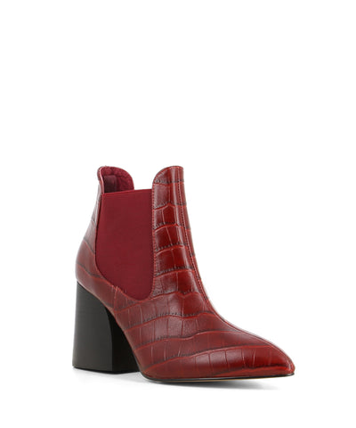 Sleek and elevated red leather Chelsea ankle boots that feature embossed croc skin texture to the upper, a large modern 8 cm block heel and a pointed toe by Zomp.