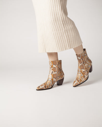 Tonal tan snakeskin leather ankle boots that have inner zipper fastening and featuring a low 5.5 cm curved wooden block heel and a soft pointed toe by Zomp.