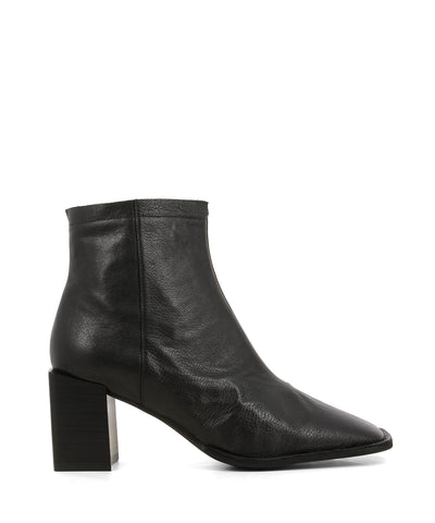 Chic black leather ankle boots featuring zipper fastenings, an asymmetrical top line, an architectural block heel and a square toe by 2 Baia Vista.