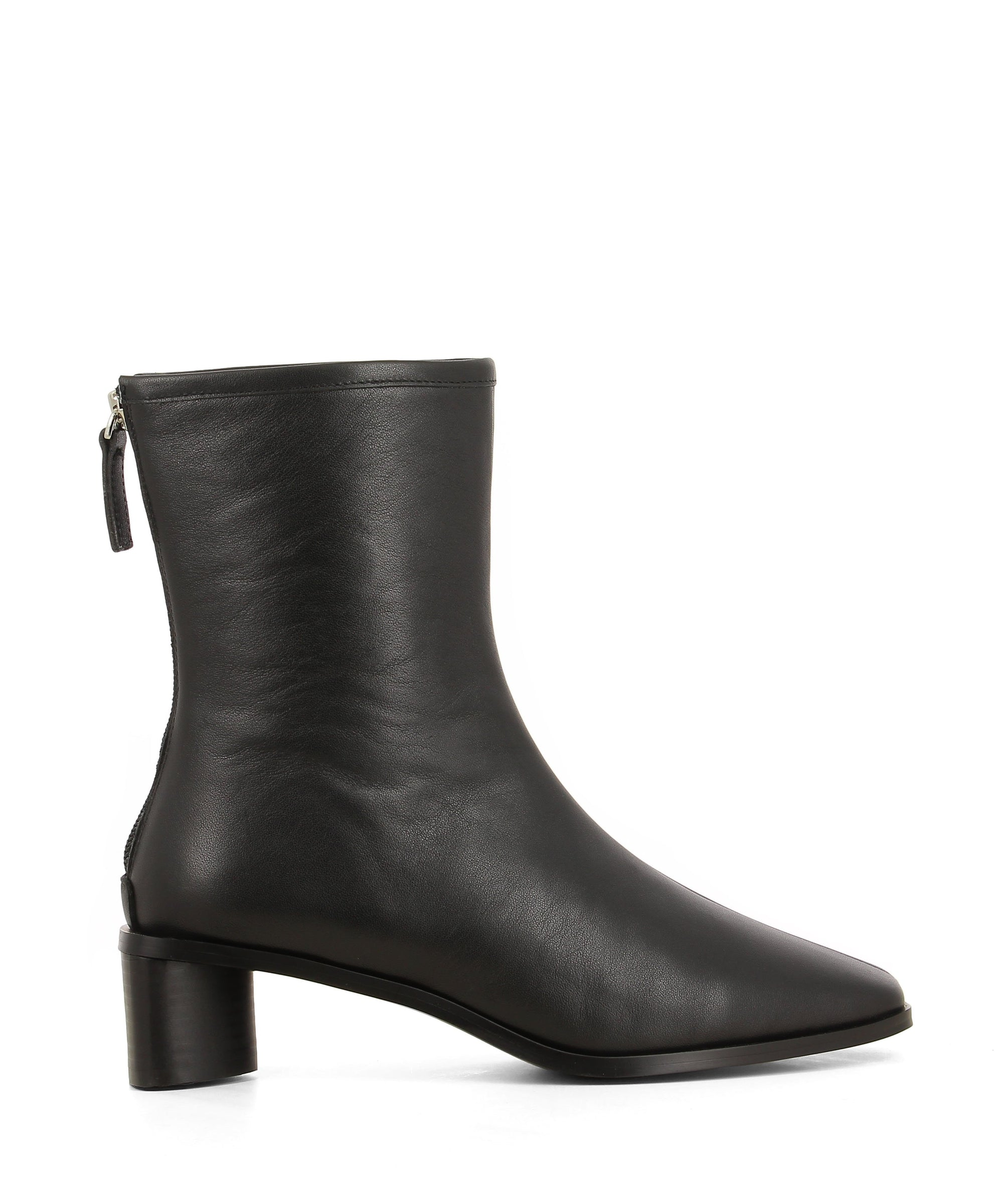 Sleek black leather ankle boots featuring zipper fastenings, seam detailing on the upper, a low block heel and a square toe by 2 Baia Vista.