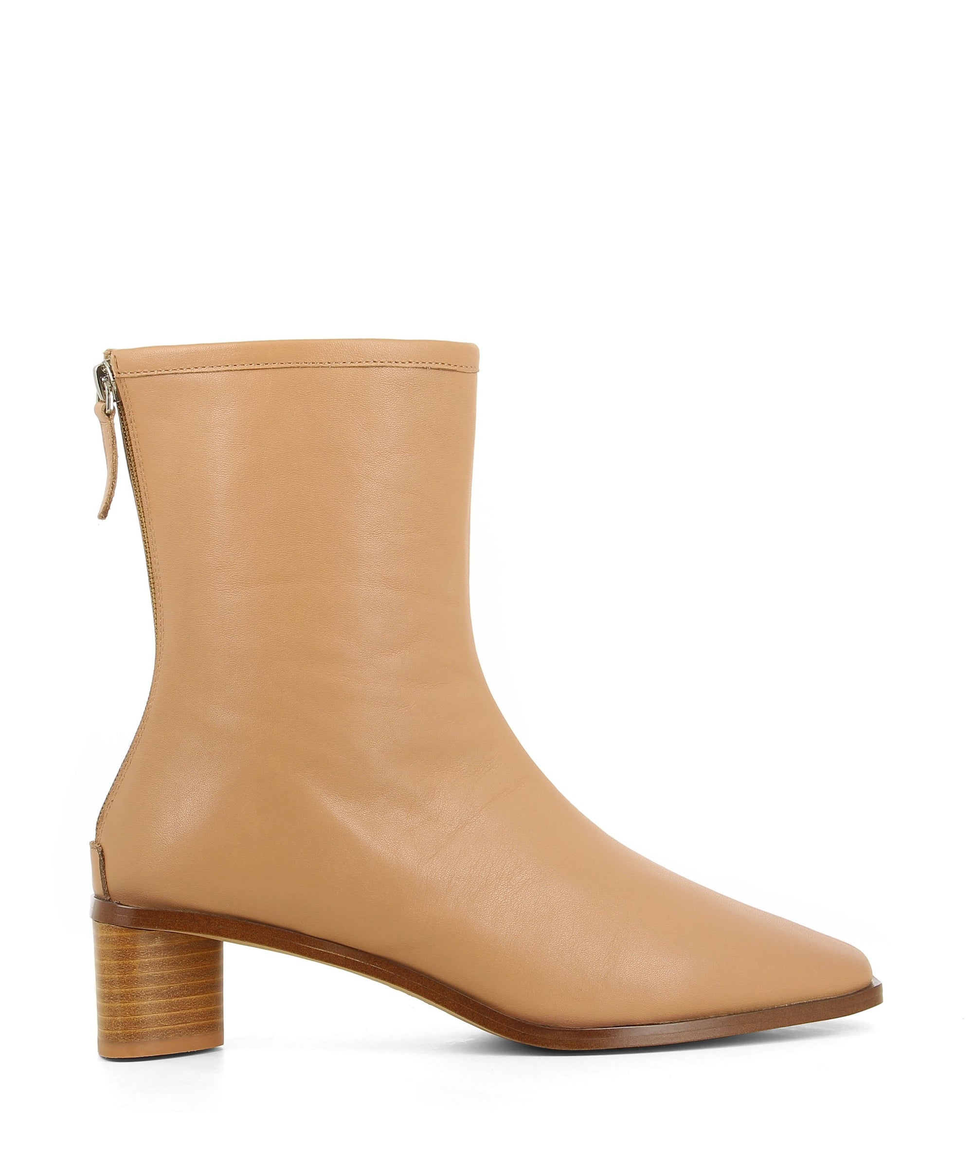 Sleek camel leather ankle boots featuring zipper fastenings, seam detailing on the upper, a low block heel and a square toe by 2 Baia Vista.
