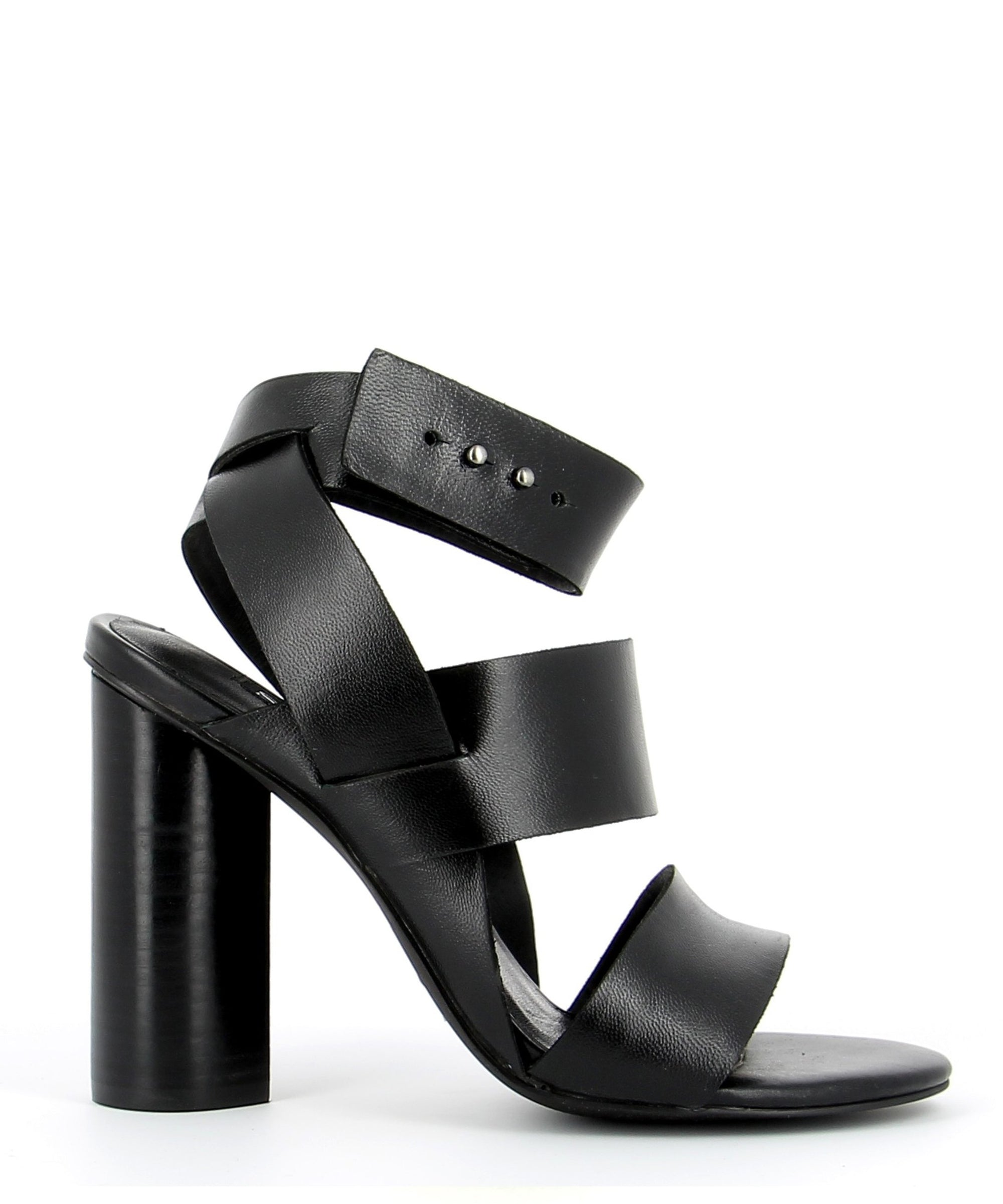 A thick strap black leather sandal by Senso. The 'Xander' has a prong fastening and features a cylindrical block heel and a round toe.