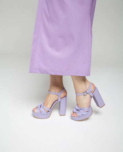 A pastel lilac leather platform sandal featuring knotted toe straps, a buckle fastening and an almond toe. Made by ZOMP - this style runs true size.