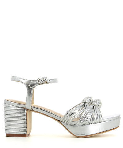 Silver leather platform sandal that has an ankle strap with a buckle fastening and features knot detail straps over the toe, a 3.5 cm platform sole, leather piping detail on the 7.5 cm block heel and an open almond by Zomp Shoez.