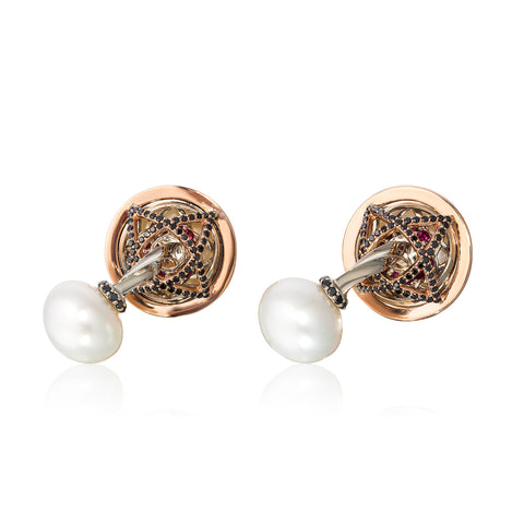 Cufflinks in 18k rose and white gold with 12–15 mm South Sea cultured pearls with 5.69 cts. t.w. black diamonds and rubies by Chris Faber of Stuller, Inc.