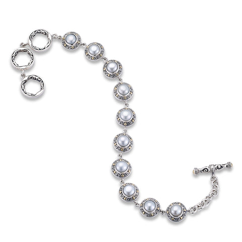 Adele bracelet in sterling silver with white freshwater mabé pearls, $574; Samuel B. Jewelry