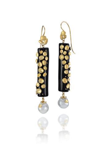 Drop Shell earrings in 18k gold with black coral and white South Sea pearls, $5,000; email terri@barbaraheinrichstudio.com for purchase