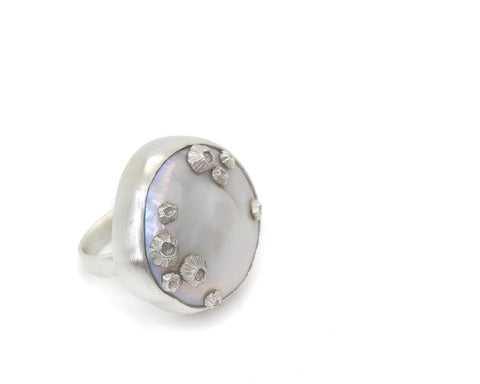 Ruthie B. ring in sterling silver with a large white baroque freshwater coin pearl and sterling silver barnacles, $710; Hannah Blount