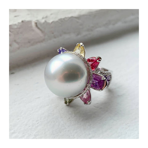 Serenity ring in 18k white gold with a 17.4 mm white South Sea pearl with 9.1 cts. t.w. multicolored sapphires and 0.91 ct. t.w. diamonds by Gina Ferranti of Gigi Ferranti