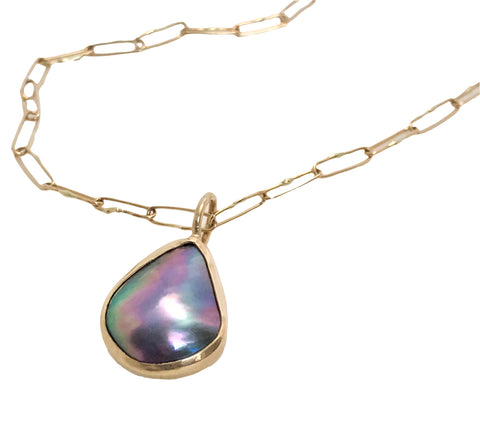 Pendant necklace in 14k yellow gold with a Sea of Cortez pearl, $1,440 ($740 for pendant alone); Ocean's Cove Jewelry