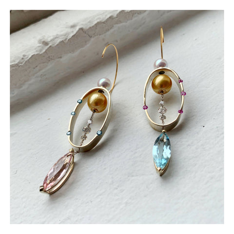 Magnetic earrings in 14k yellow and white gold with marquise-shape aquamarines and morganites, cultured golden South Sea and akoya pearls, pink sapphires, and blue and colorless diamond briolettes by Mark Loren