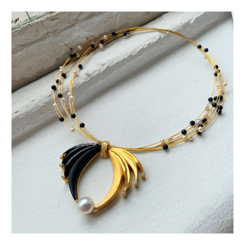 Condor necklace in sterling silver and 14k yellow gold with a 37.52 ct. black onyx, a white South Sea pearl, 17.01 cts. t.w. black onyx beads, white freshwater pearls, and 1.10 cts. t.w. diamonds by Brenda Smith Jewelry