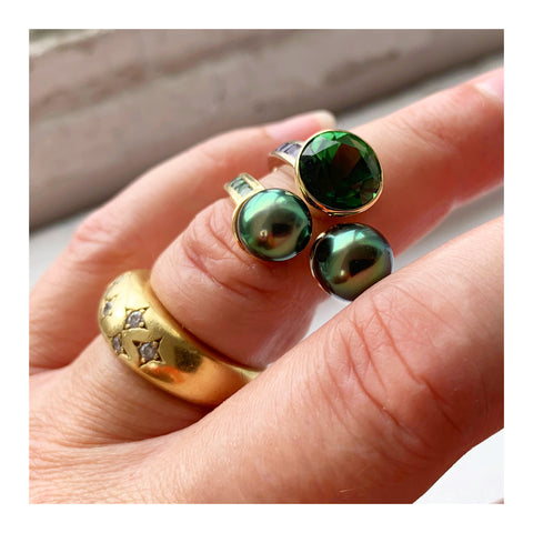 Ring in 18k white and yellow gold with a 3.81 ct. green tourmaline and two 2–8 mm cultured Tahitian pearls with 1.52 cts. t.w. sapphires and 0.40 ct. t.w. tsavorite garnets by Lara Alexander of FWM Jewelry