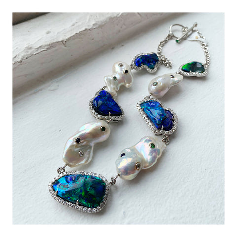 Necklace in platinum with 51.75 cts. t.w. black opals, cultured freshwater pearls, 4.12 cts. t.w. diamonds, 0.43 ct. t.w. tsavorite garnet, and 0.42 ct. t.w. sapphires by John Ford of Lightning Ridge Collection by John Ford