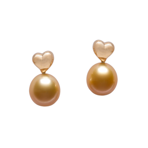 Heart-style earrings in 18k yellow gold with golden South Sea pearls are from the Petits Coeurs collection by Jewelmer. According to the brand, heart motifs symbolize love and meaningful connection and its passion for artistry and the planet. Email marion.branellec@jewelmer.com for purchase.