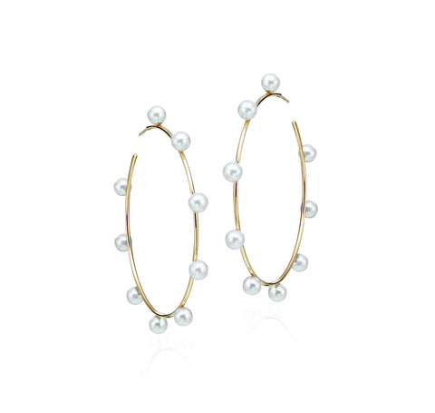 Large 60 mm hoops in 14k yellow gold with 6 mm freshwater pearls, $1,520; LexiMazz Designs