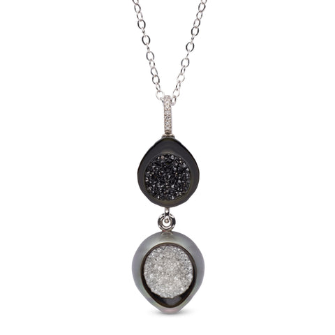 Day-to-Night pendant necklace by Hisano Shepherd of Little h Jewelry in Los Angeles. Made in 14k gold with sliced and carved Tahitian pearls and black and colorless diamonds.