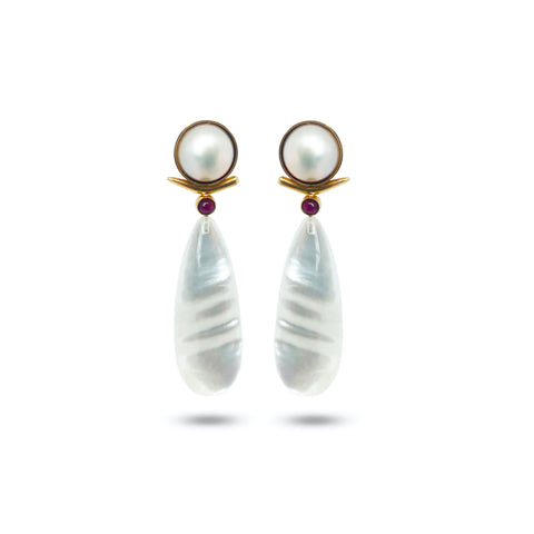 Piete drop earrings in 18k gold with round white 13.5 mm freshwater mabé cultured pearls, mother-of-pearl drops, and 0.80 ct. rubies, $5,480; Ashleigh Branstetter Jewelry