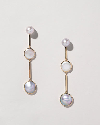 Drop earrings in 14k yellow gold with two Sea of Cortez pearls, two white coin-shape freshwater pearls, and two white freshwater mabé pearls, $4,600; Mociun