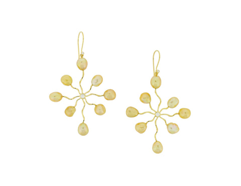 Sea Star earrings by Mary Kay and Patrick Mohs of Patrick Mohs Jewelry in Wayzata, Minn. Made in 18k gold with golden South Sea pearls and diamond accents.