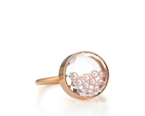 Concha ring in 18k rose gold with natural-color pink freshwater pearls encased in a white sapphire kaleidoscope shaker, $1,900; Moritz Glik