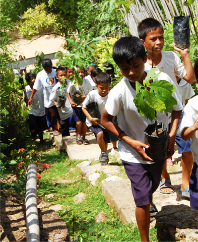 Children participating in planting trees as part of the Save the Palawan Seas Foundation