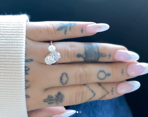 Ariana Grande in her pearl and diamond engagement ring Source: @arianagrande