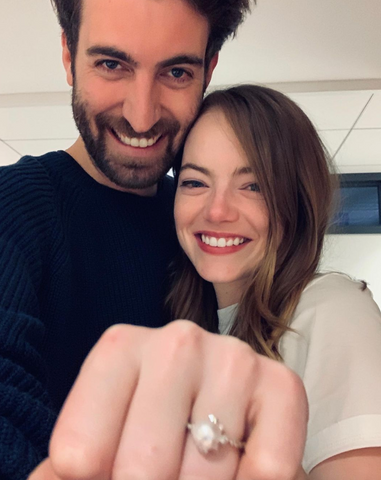 Emma Stone and Dave McCary with their pearl engagement ring. Source: @davemccary