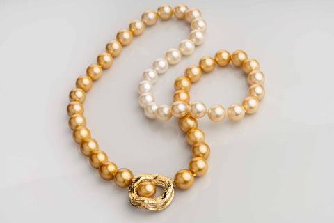 Golden pearl strand with Wavy O interchangeable clasp by Llyn Strong of Llyn Strong Jewelry
