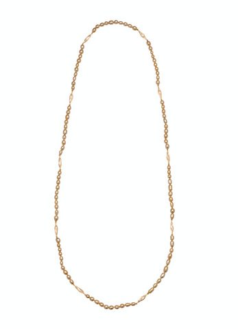 Necklace in 18k yellow gold with golden South Sea keshi pearls from the Caravelles collection by Jewelmer. Caravelle depicts the fluid lines of excitement present in long voyages, like those taken by the Portuguese in the 16th century on caravel ships. Email marion.branellec@jewelmer.com for purchase.