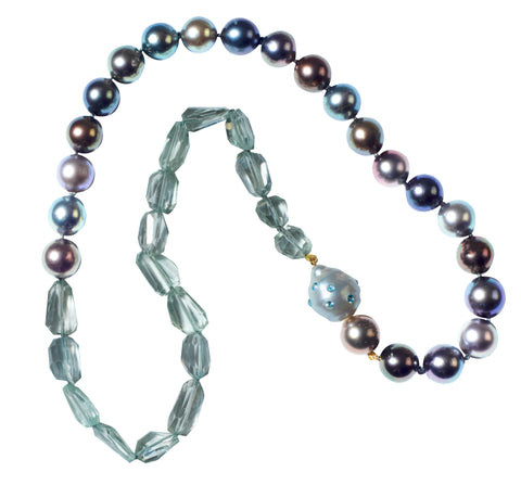 Twenty-inch necklace in Tahitian pearls and praisiolite with a proprietary South Sea pearl clasp inset with blue topaz, $1,295; Judi McCormick Jewelry