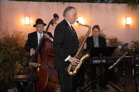 He's with the band—seriously, the saxophonist is jamming with the band CPAA hired for the 2018 annual Pearl Soiree.
