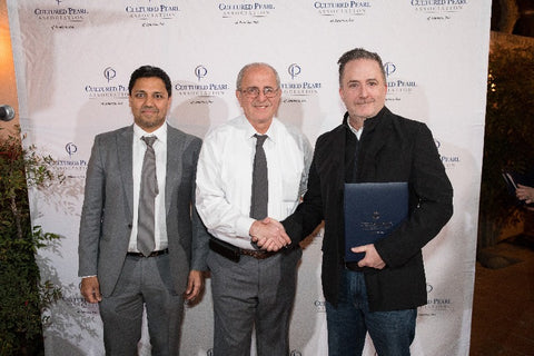 Anil Maloo and Aziz Basalely with IPDC winner Phillip Dismuke of Jewelsmith