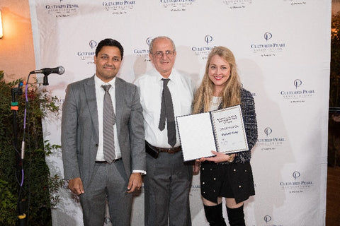 From left: Anil Maloo and Aziz Basalely with Elizabeth Dilly Kirby, CPAA member and owner of Elizabeth Blair Fine Pearls, who is receiving an IPDC award