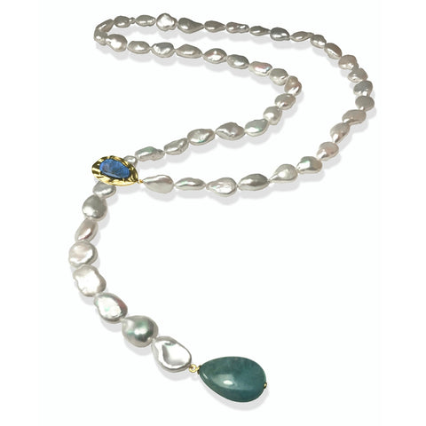 Tresa lariat in 14k yellow gold with white freshwater keshi pearls, a 26 ct. teardrop labradorite, and a 3.98 ct. lapis, $1,560; K. Mita