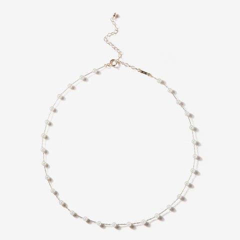 Station necklace in 14k gold with white freshwater pearls, $725; Mizuki