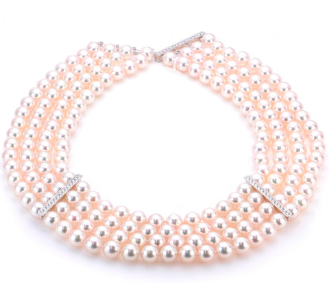 Choker in 18k white gold with high-luster 8.5 mm to 9 mm white akoya pearls and 1.47 cts. t.w. diamonds, $18,000; Imperial