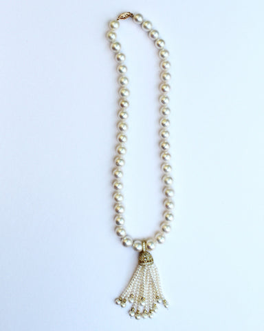Necklace in 18k yellow gold vermeil with a 14k yellow gold clasp, 9.5 mm to 10 mm white freshwater pearls, and a removable tassel with cubic zirconia, $1,160; Brenda Smith