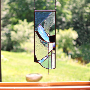 Small stained glass panel with organic lines made by Vermont artist Julia Brandis. Organic abstract.