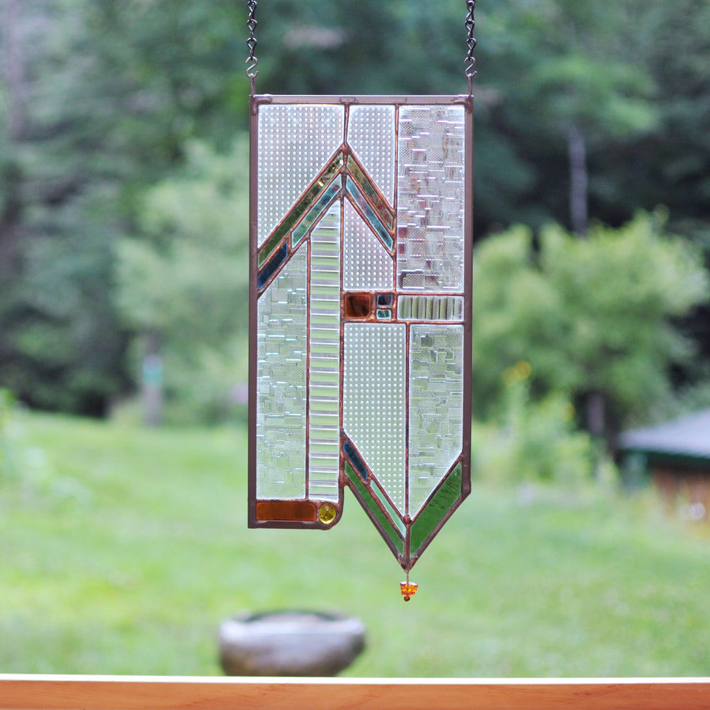 Stained glass panel with architectural lines made by Vermont artist Julia Brandis. Mission style / Prairie style.