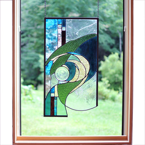 Large stained glass panel with nature inspired organic lines. Organic abstract