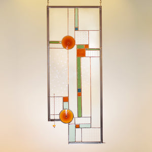Large stained glass panel with amber rondels and clear architectural textures made by Vermont artist Julia Brandis. Mission style / Prairie style.