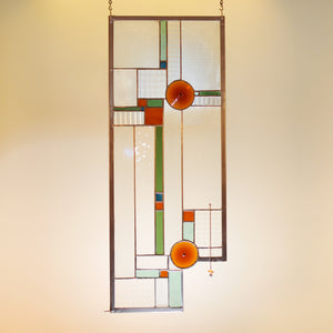 Large stained glass panel with amber rodels and clear architectural textures made by Vermont artist Julia Brandis. Mission style / Prairie style.