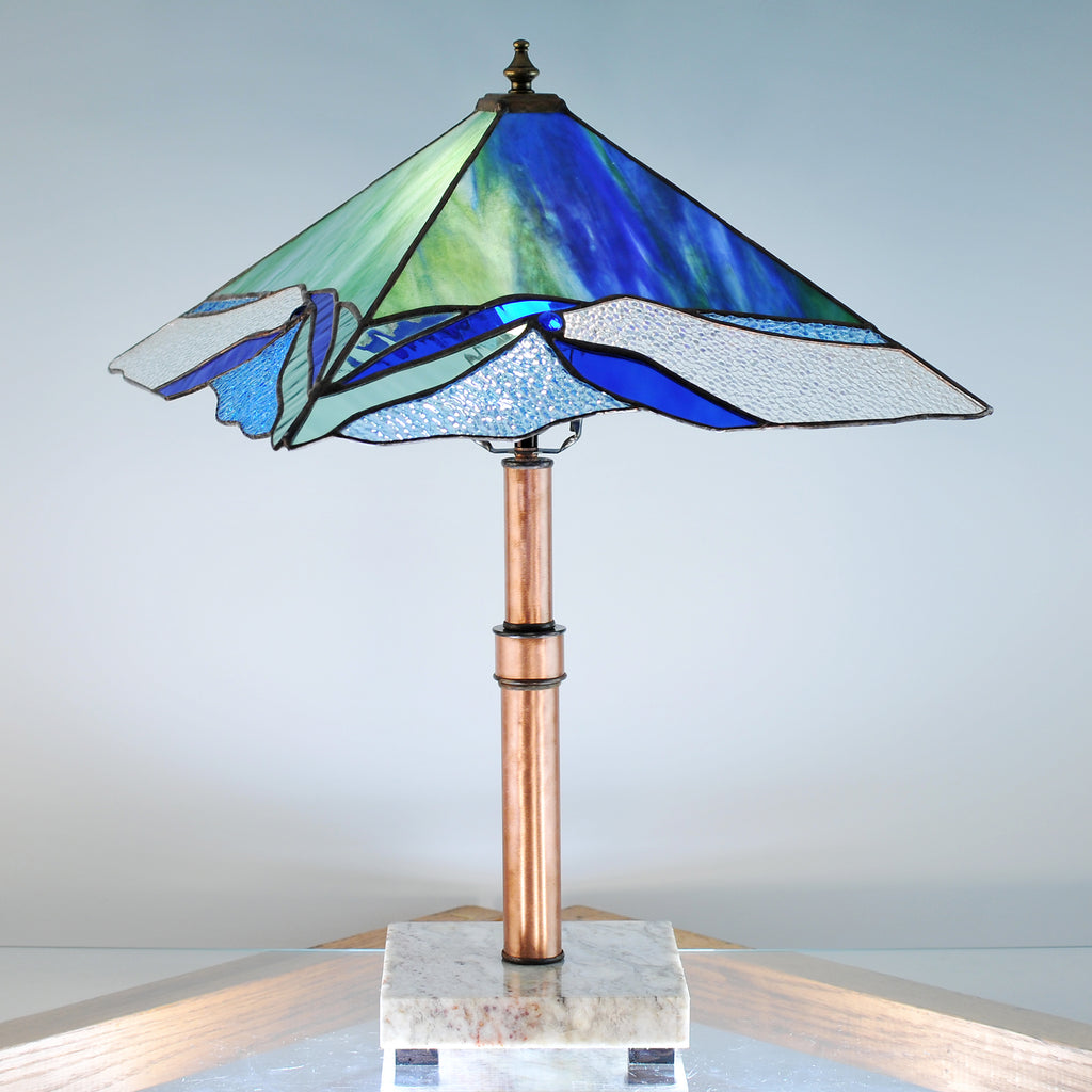 Large stained glass lamp with organic swirls made by Vermont artist Julia Brandis. Organic abstract.