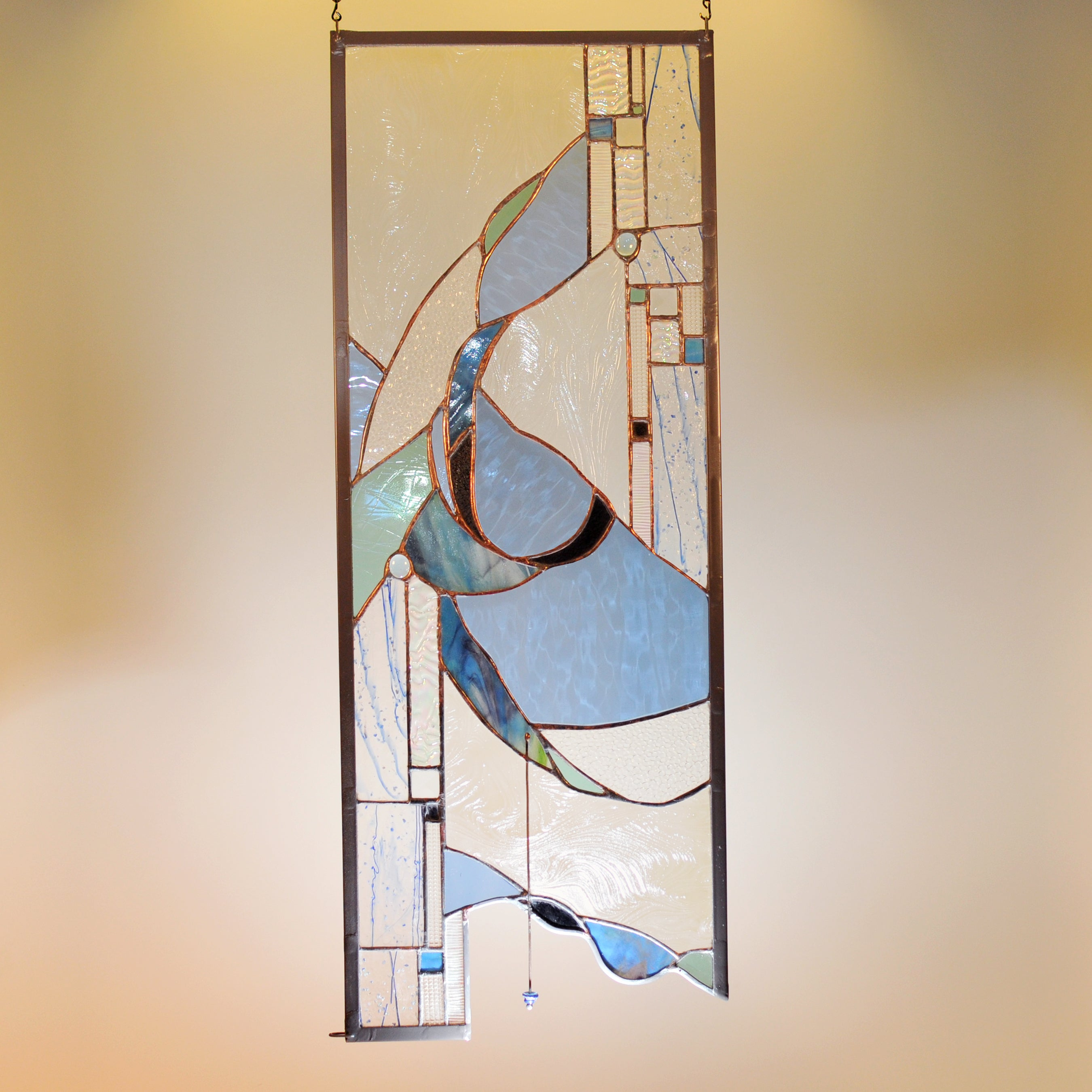 Large stained glass panel with nature inspired organic swirls made by Vermont artist Julia Brandis. Organic abstract.
